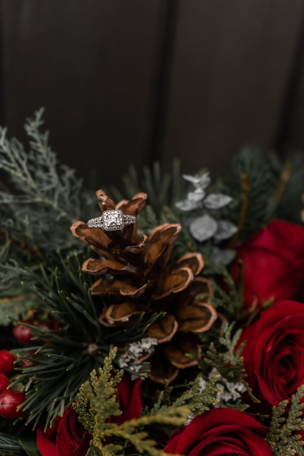 engagement ring in winter Christmas floral bouquet alexis Burton Hamilton wedding photographer