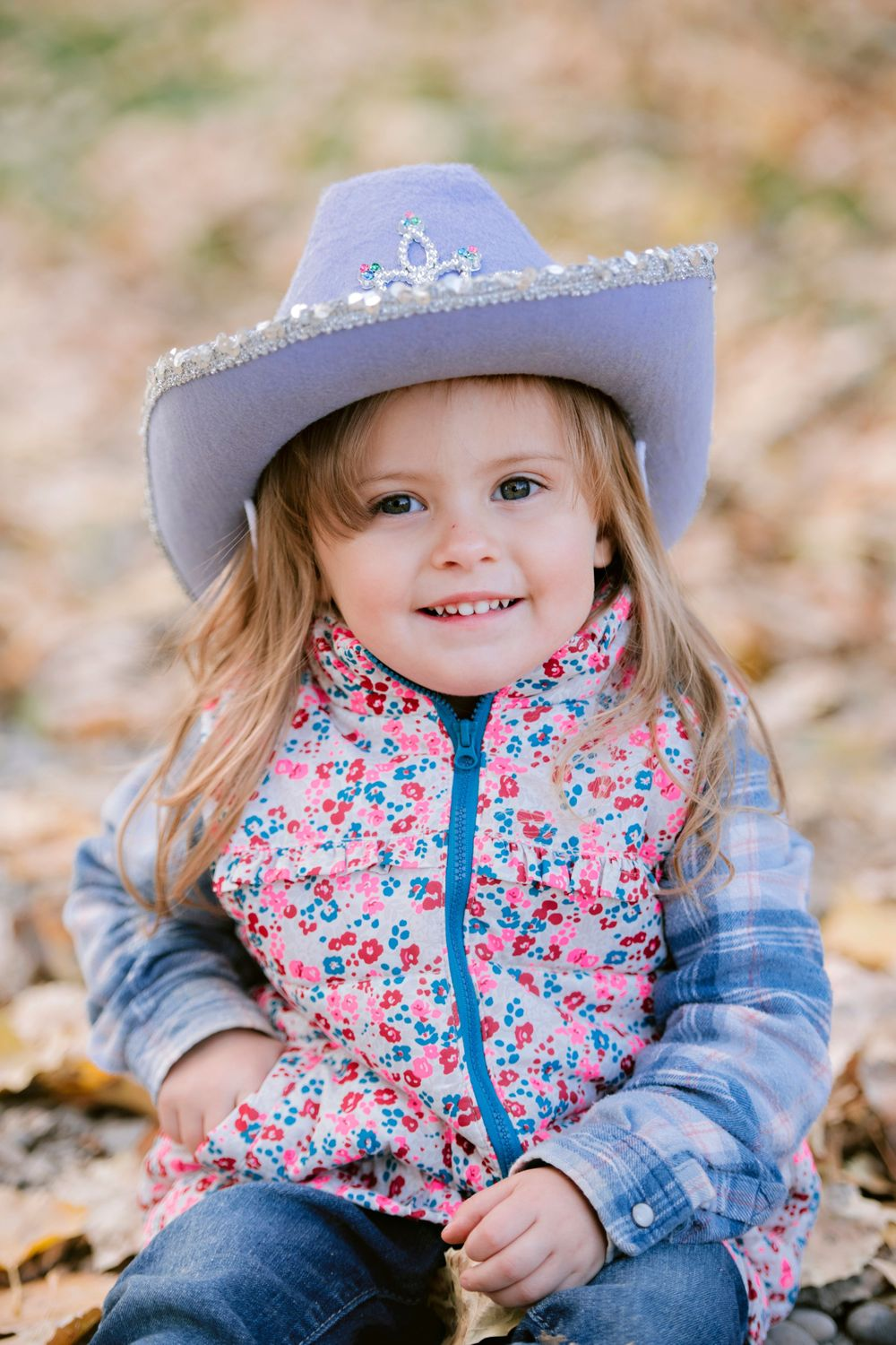 Happy smiling girl in cowboy hat