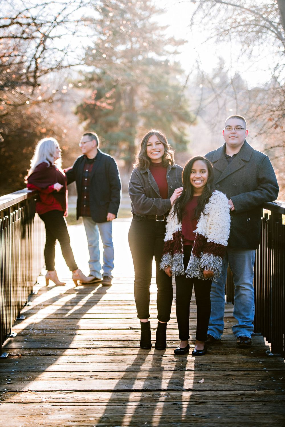 Parents and kids pose on a bridge in Kathryn Albertson Park