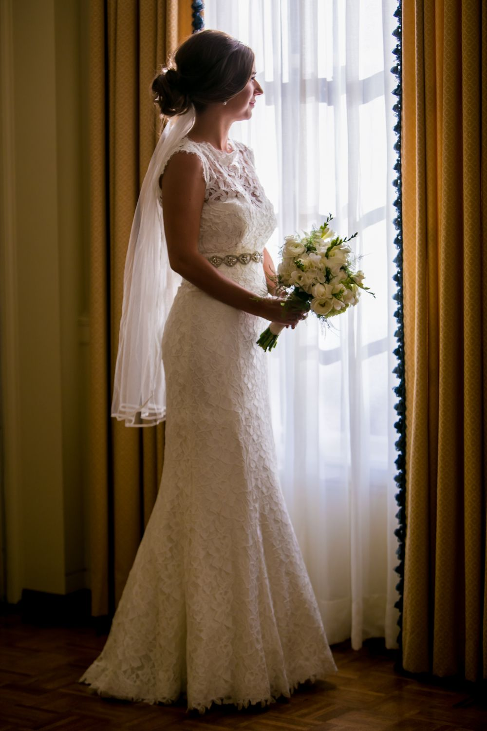 Bride Page looks out the window before her wedding at Eastminster Presbyterian Church in Columbia, SC.