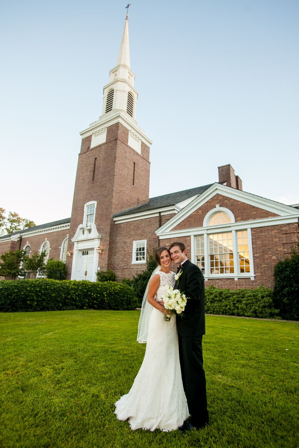 Bride Page and groom John outside after their wedding at Easminster Presbyterian Church in Columbia, SC.