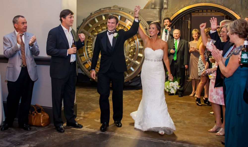 Bride Page and groom John make their entrance at their reception at 1208 Washington Place in Columbia, SC