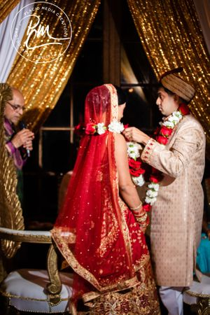 The Couple Exchanges Floral Garlands During the. Jai Mala