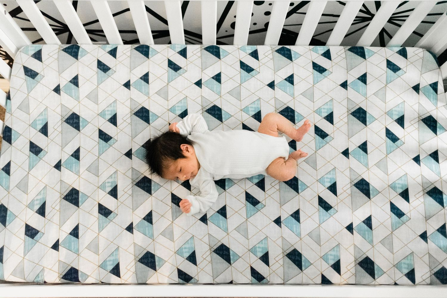 lifestyle newborn session with newborn baby in crib