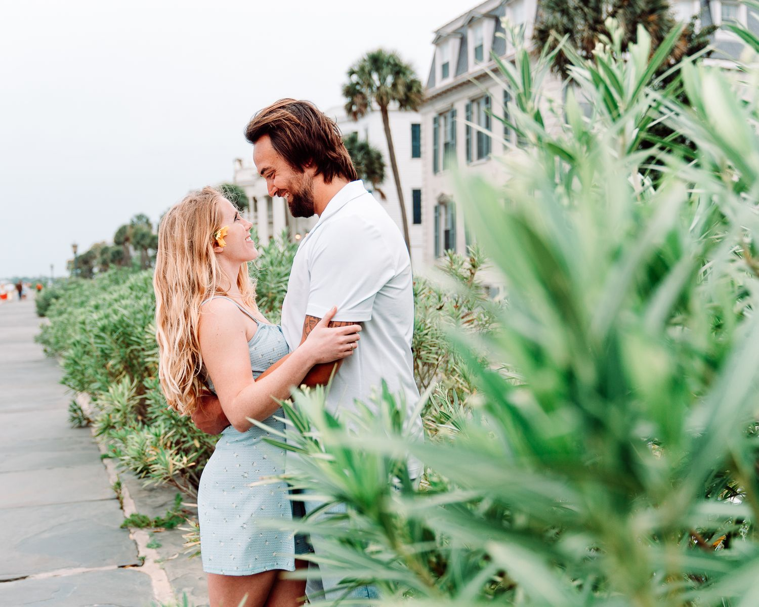 Engagement session of Couple kissing and lauging at the battery in charleston south carolina, photo by PHV Photo