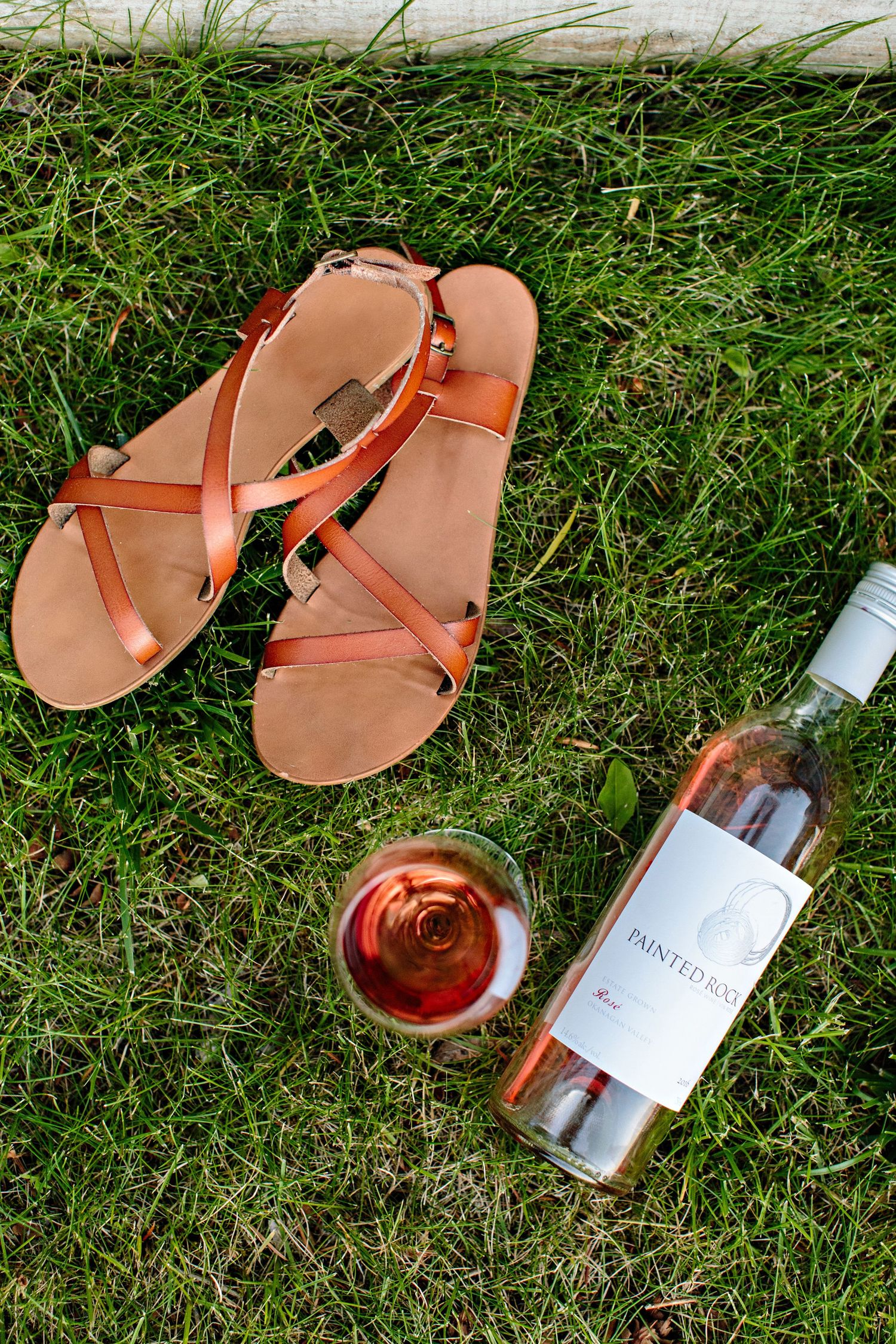 sandals and rose wine