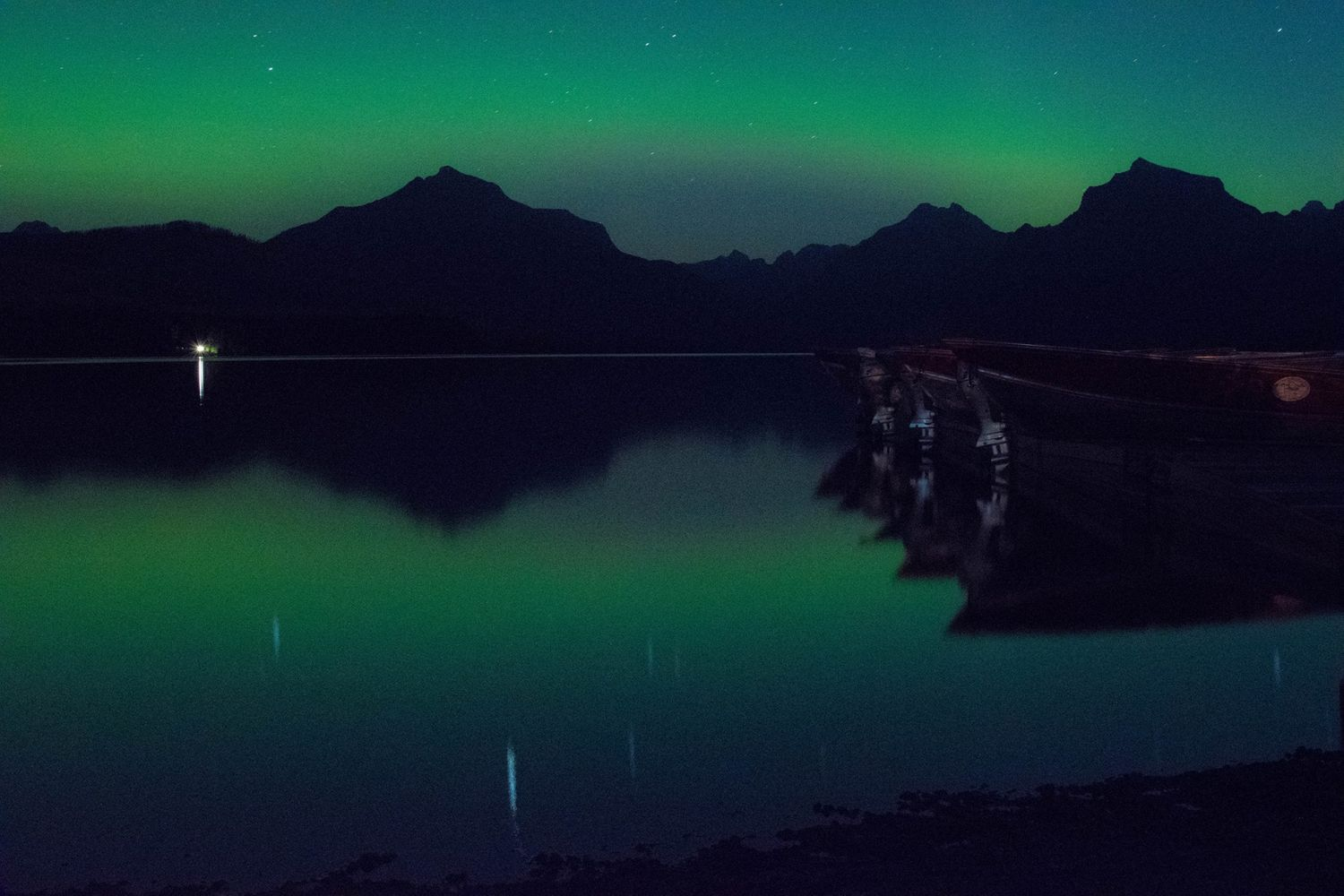 Northern lights at lake McDonald in glacier national park July 2017