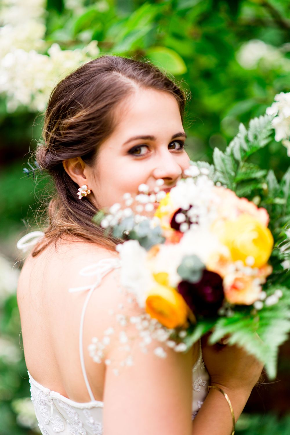 bride peeks through her fall diy wedding bouquet at Woman's Club of Evanston Garden Wedding in Chicago