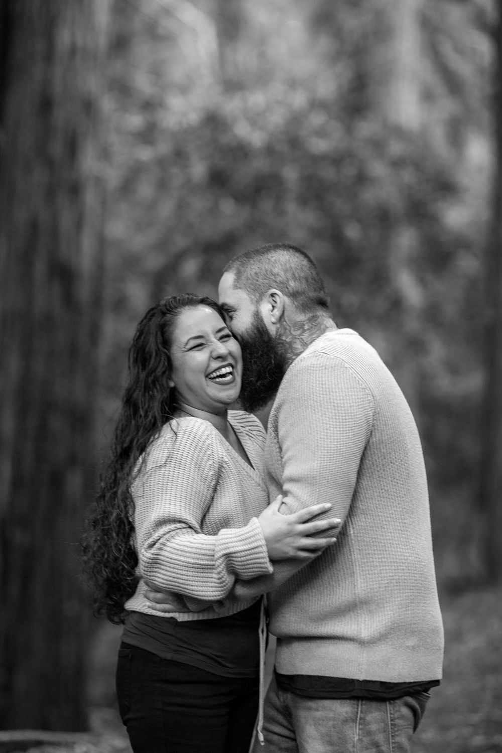 rebecca skidgel photographer engagement session at north sonoma mountain couple smiling at each other in forest