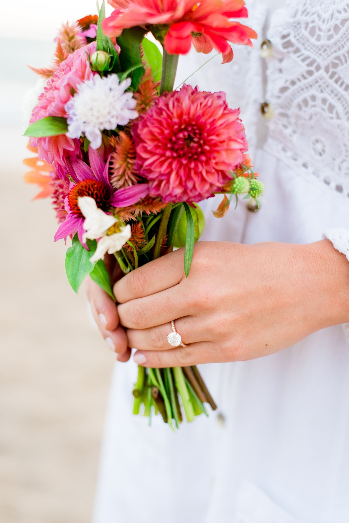 bride holding pink dahlia bouquet for Chicago sunrise engagement pictures