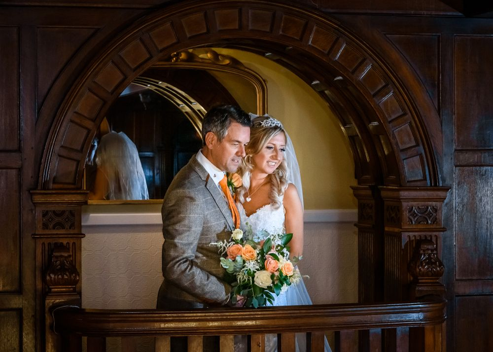 Bride and groom on Minstrels' Gallery at Langdale Chase Hotel