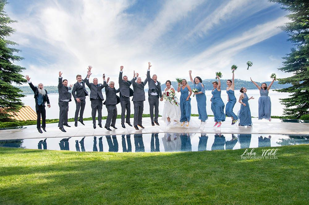 wedding bridal party jumping by lake Coeur d' Alene, taken at Hagadone event center by Photography By Luba