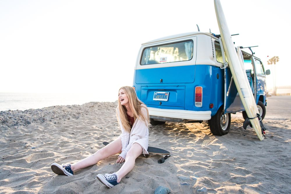 Image of a high school senior sitting with a VW Bus in Dana Point, CA