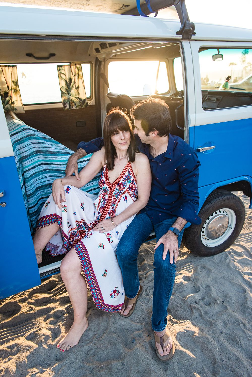 Image of a husband and wife sitting in a classic VW Bus in Dana Point, CA
