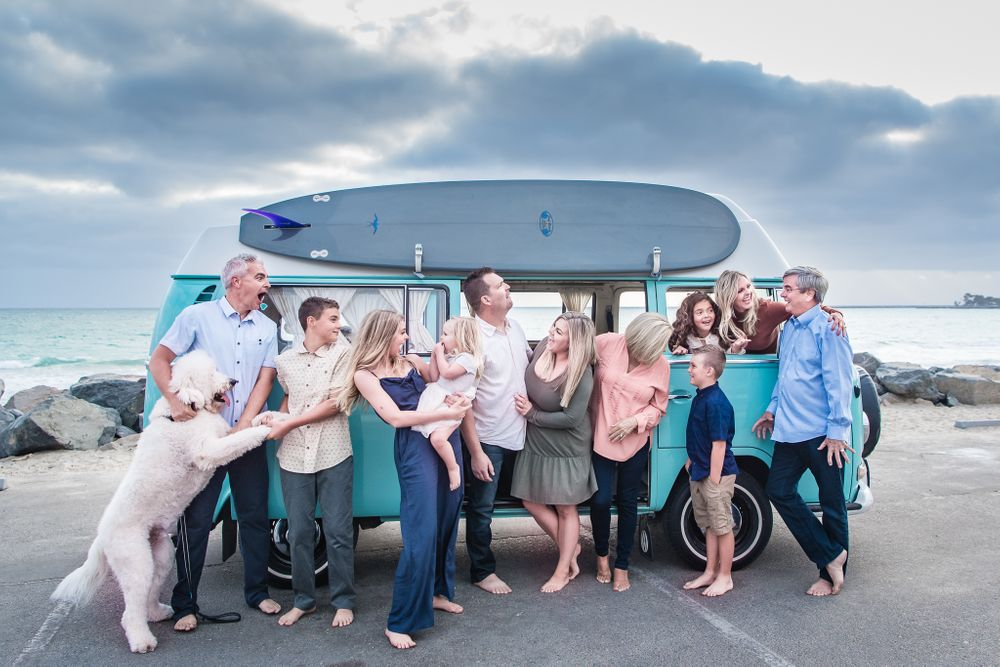 Image of a large extended family in front of a VW Bus in Dana Point, CA