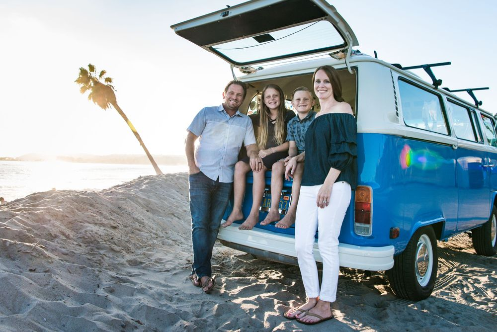 image of a family with a classic VW Bus at the beach in Dana Point, CA