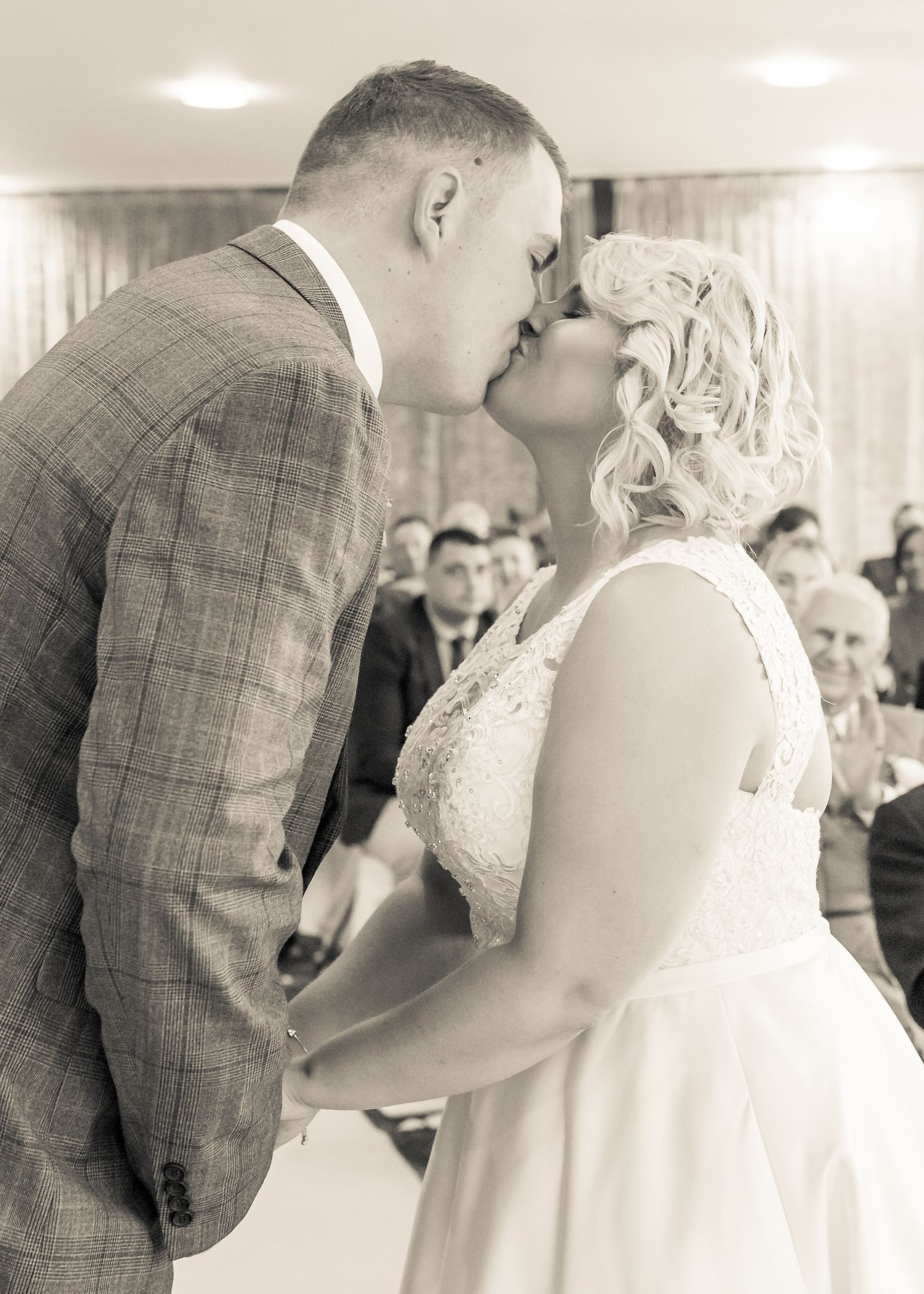 bride and grooms first kiss as husband and wife at ribby hall village