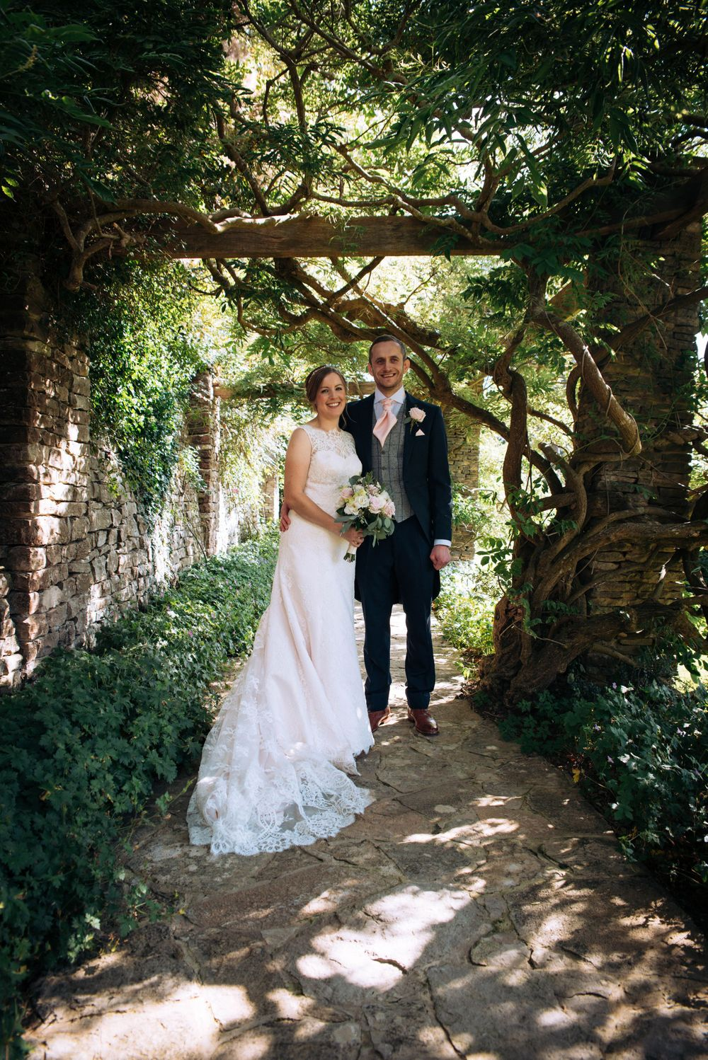 Zara Davis Wedding Photography Near Stroud, Gloucestershire, Cotswolds Glenfall House greenery and bride and groom