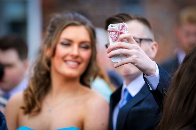 couple pose for a selfie outside mansion house st.helens