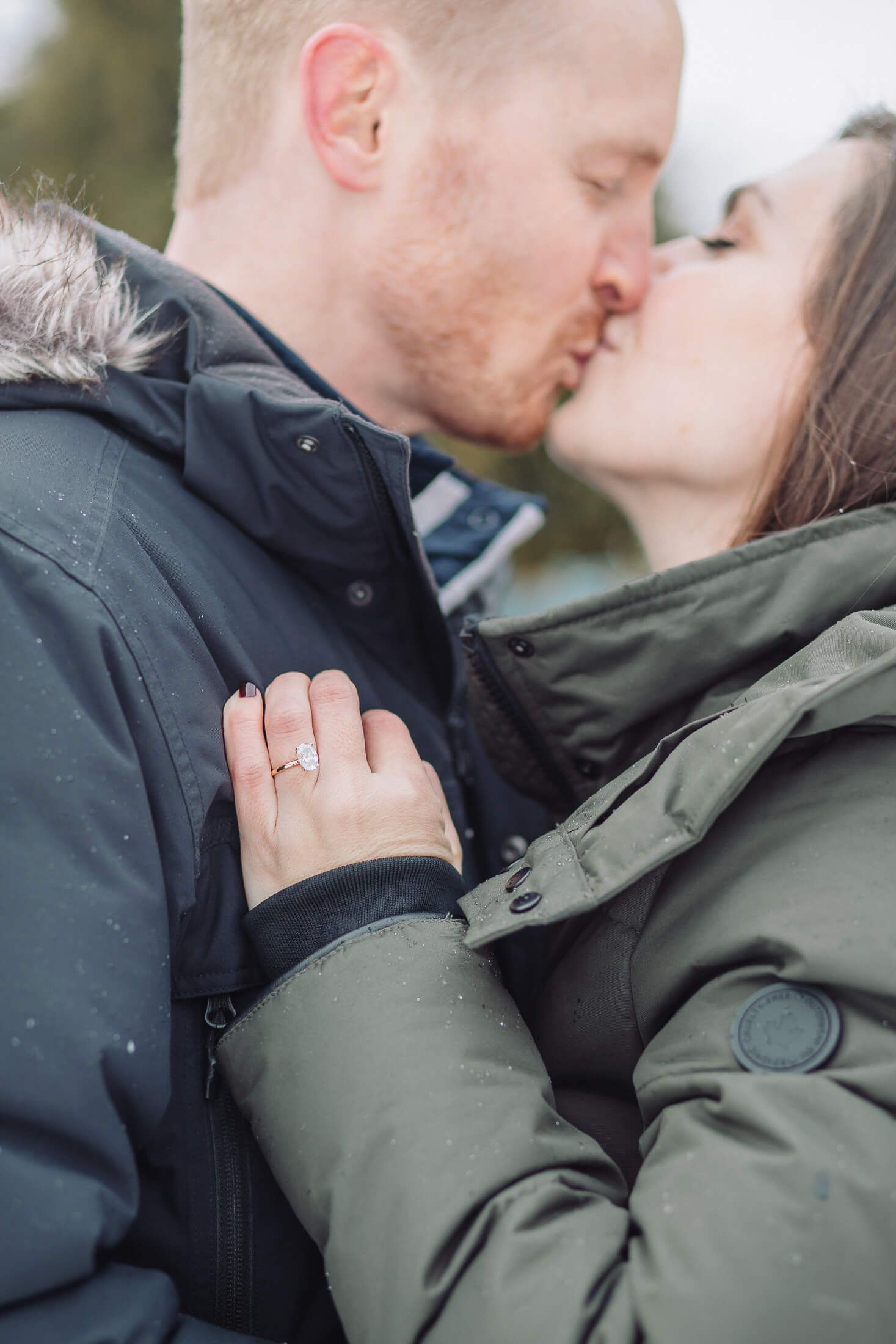 Couple in the snow with Cherry Hill engagement photographer.