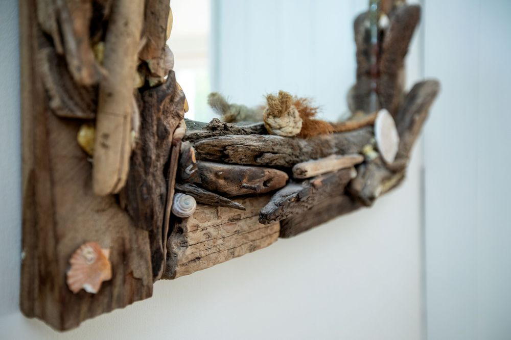 Close up image showing the detail in as driftwood mirror frame.