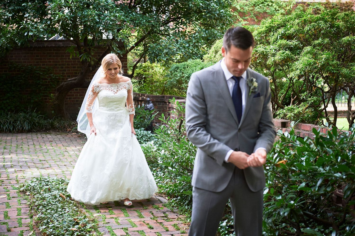 bride approaches groom during first look at Colonial Dames in Philadelphia