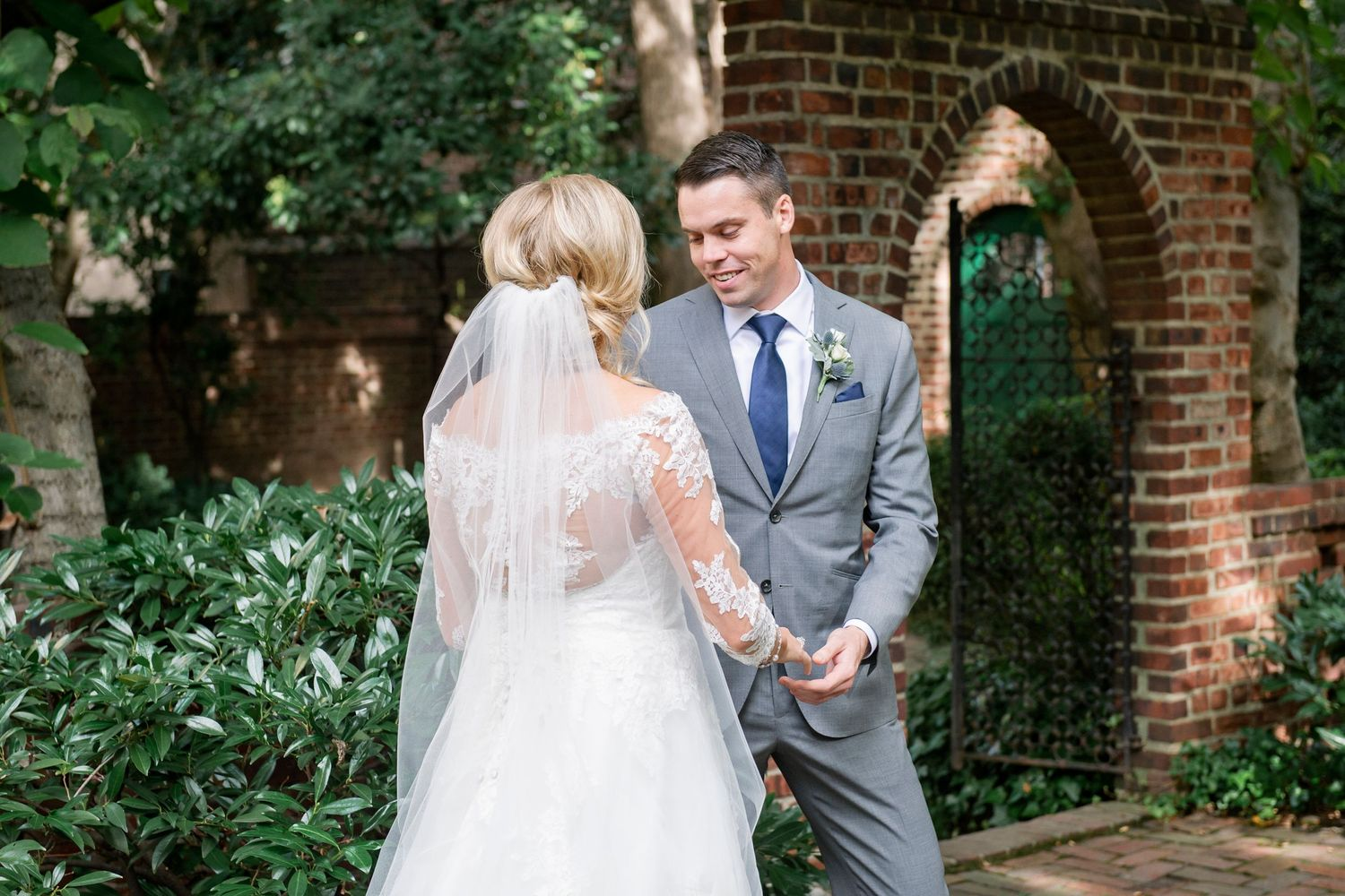 groom turns and sees bride during first look at Colonial Dames in Philadelphia