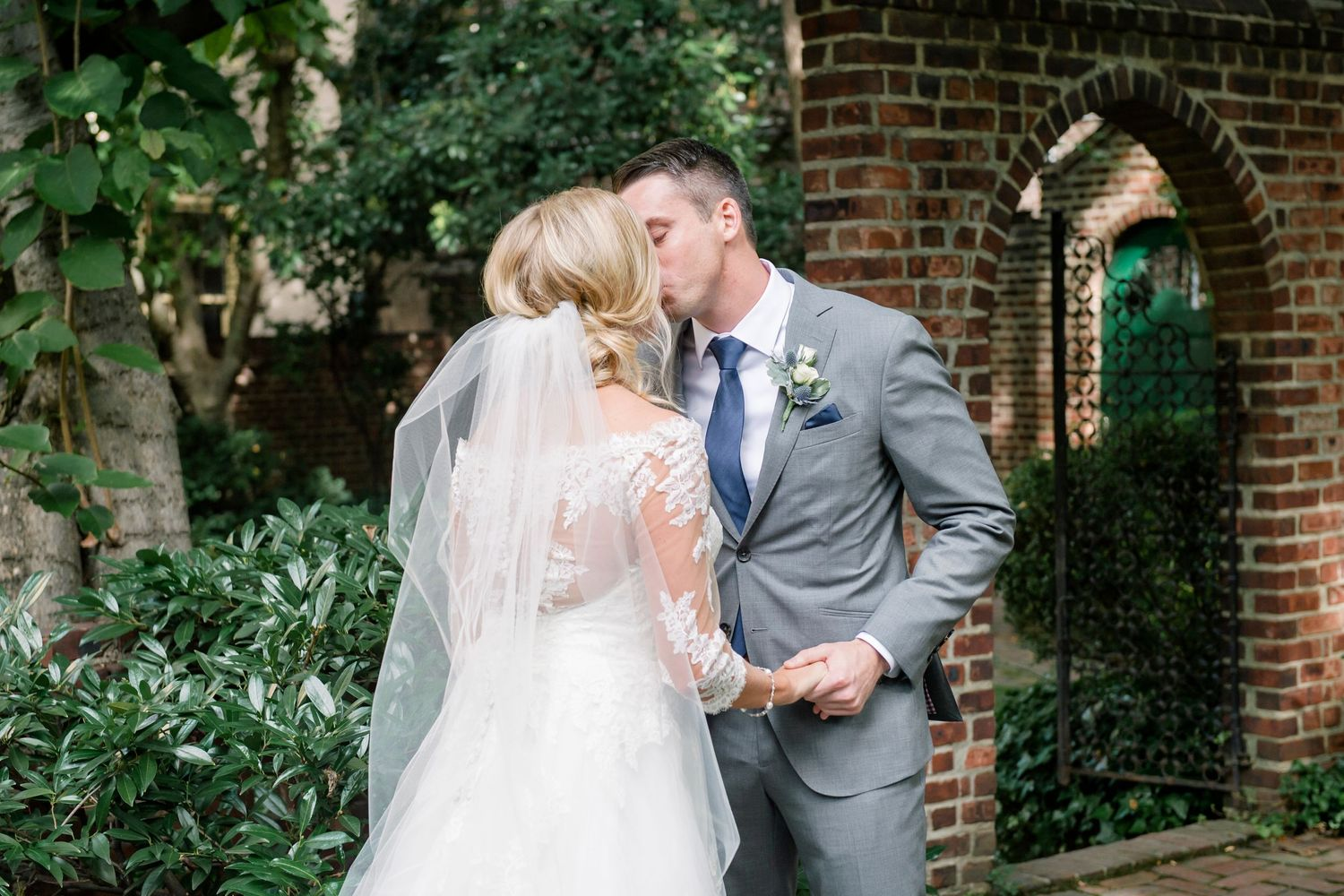 broom kisses bride at Colonial Dames in Philadelphia