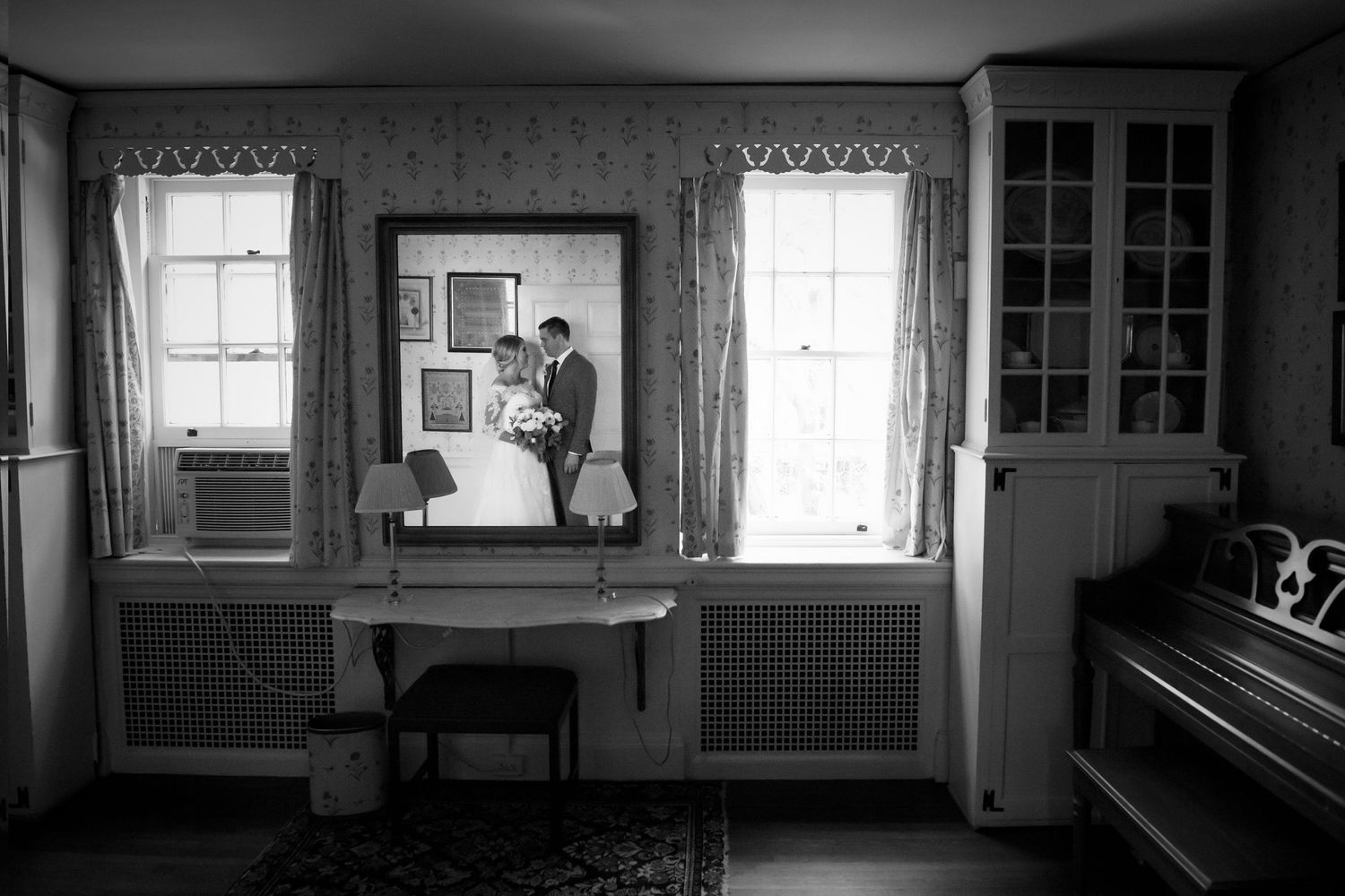 room shot at Colonial Dames in Philadelphia with bride and groom reflected in mirror