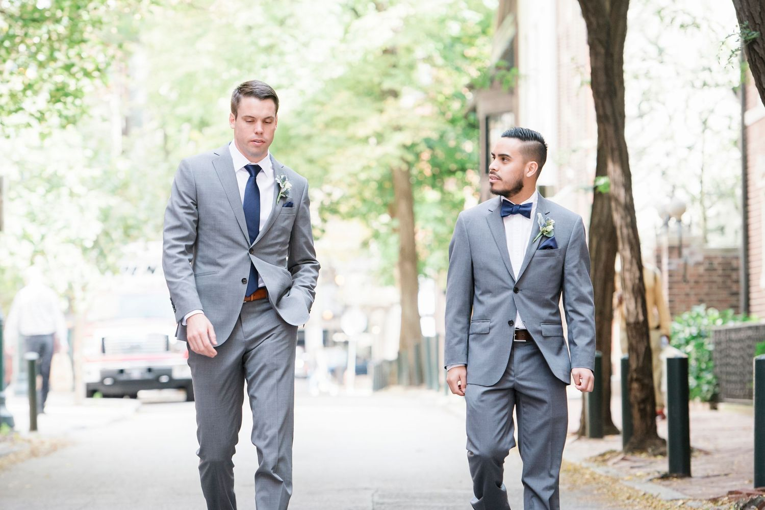 groom and best man walking in the street