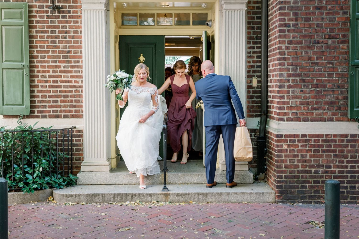 bride leaving Colonial Dames in Philadelphia for the church