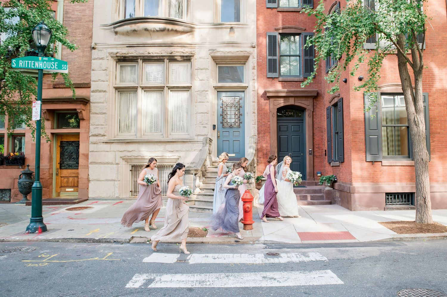 bride and bridesmaids walking in Rittenhouse Square on way to the church