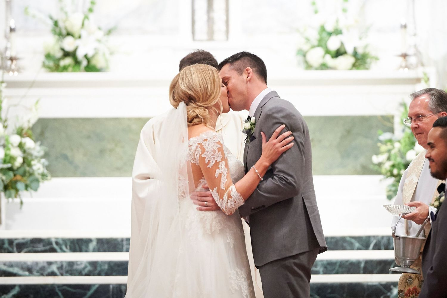 bride and groom's first kiss at St. Patrick's Church