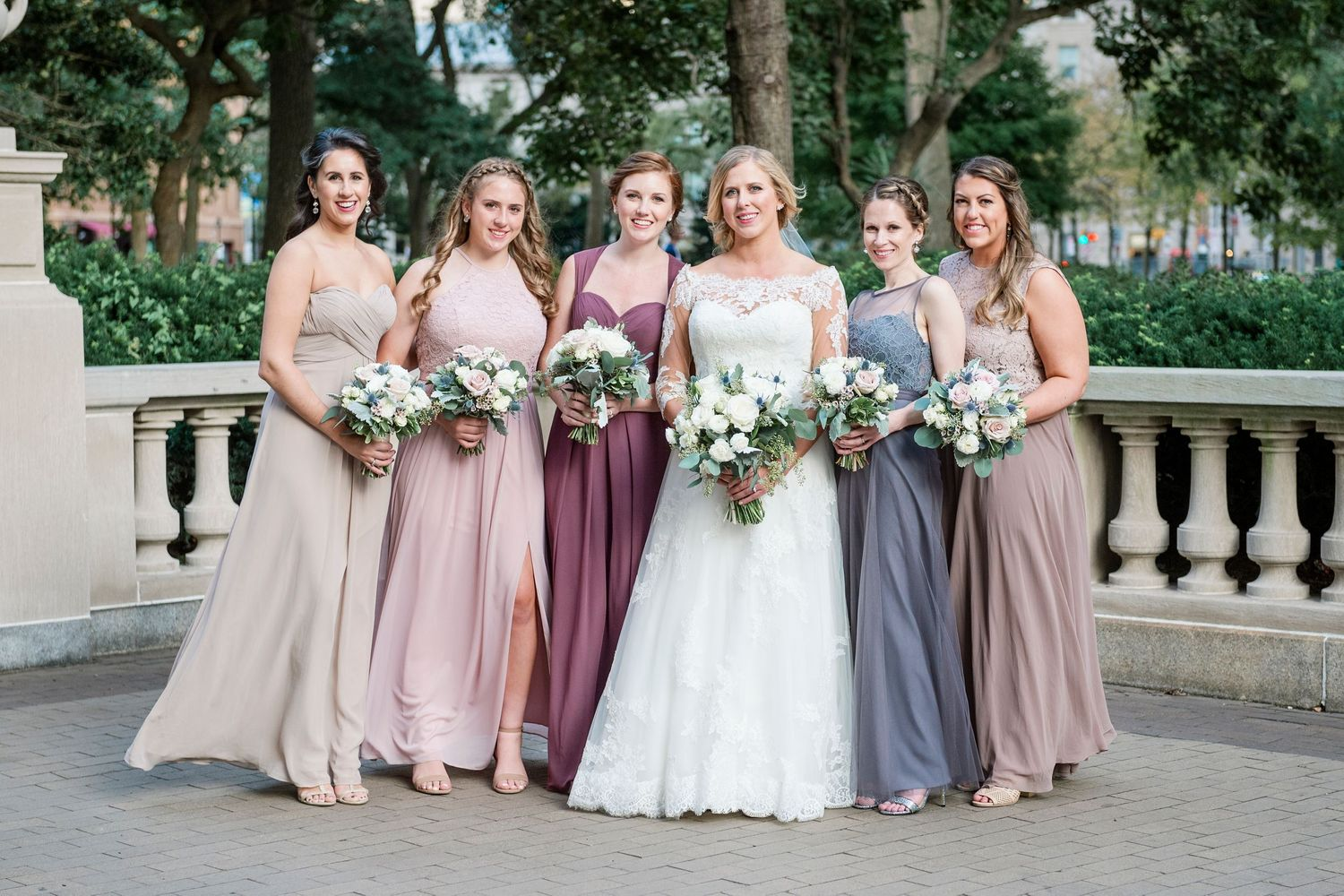 Bride and bridesmaids in Rittenhouse Square in Philadelphia