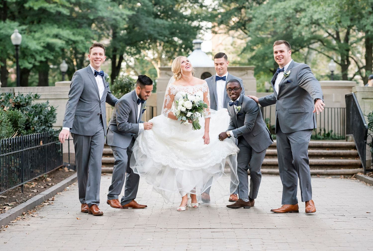 Groomsmen escorting the bride in Rittenhouse Square in Philadelphia