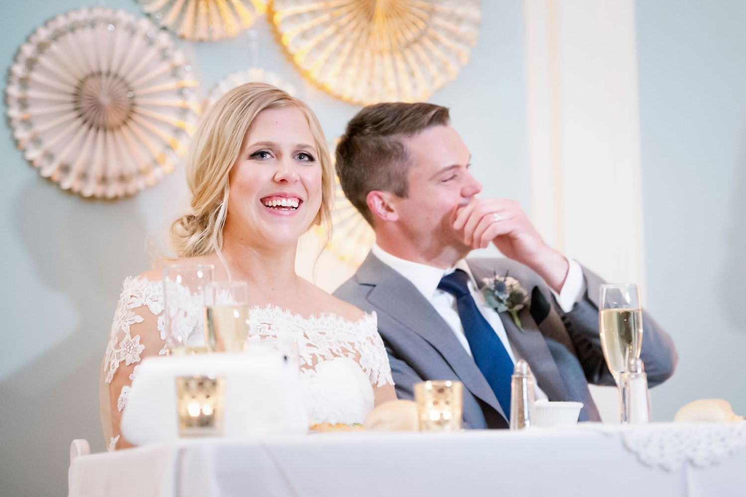 bride and groom laugh during speeches at Colonial Dames in Philadelphia