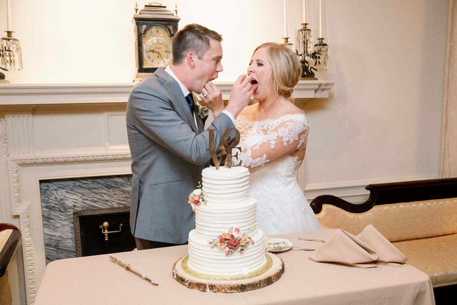 bride and groom feeding each other cake at Colonial Dames in Philadelphia
