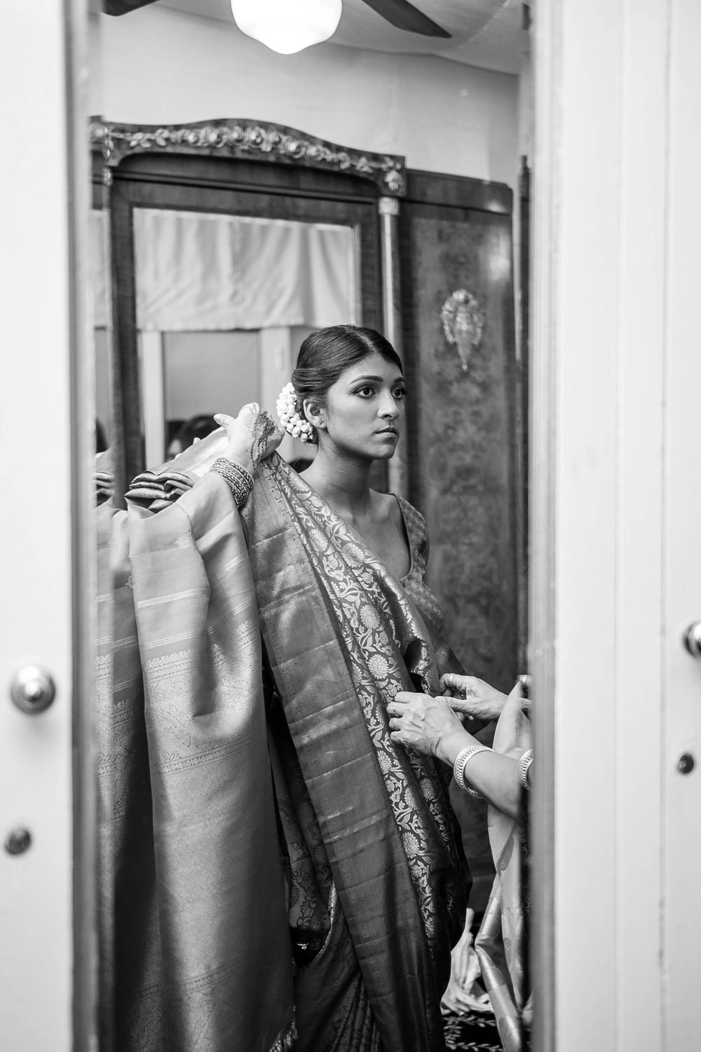 rebecca skidgel photography grand island mansion indian wedding bride getting ready looking in mirror