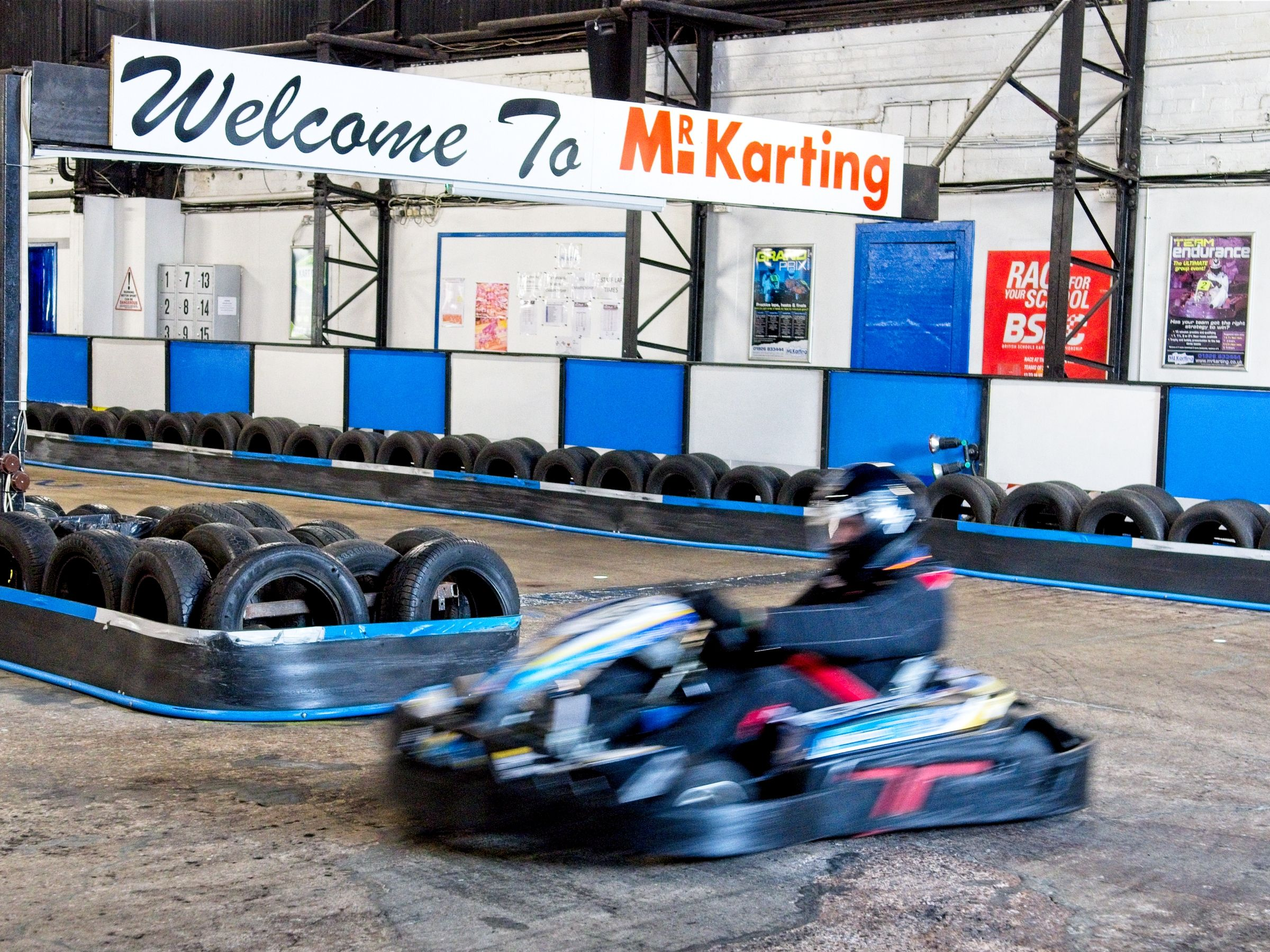 mr karting leamington spa a male driver exiting a bend slightly blurred image showing speed and movement