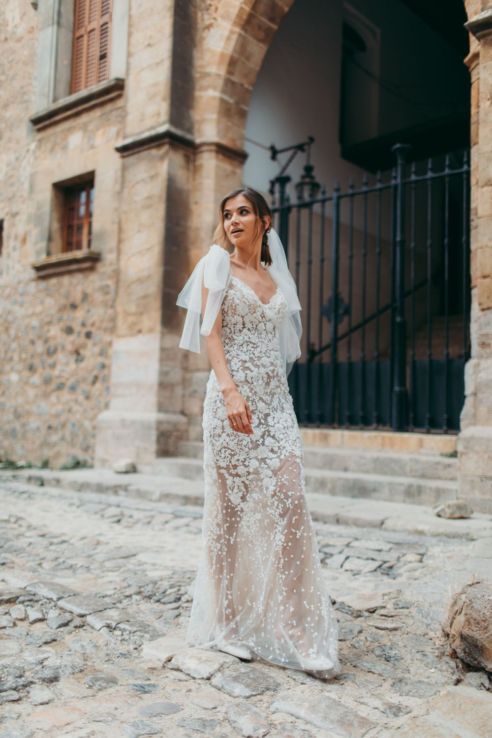 Gorgeous bride from Ukraine getting married in Mallorca, Valldemossa, wearing a lace dress