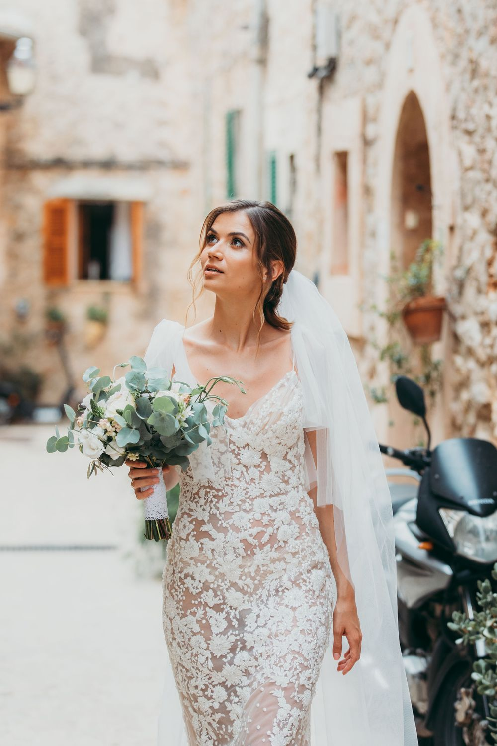 Gorgeous bride wearing a lace dress in Valdemossa, Mallorca, lace-wedding-dress