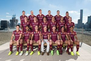 Rugby league compact team photo with city skyline background