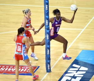 Netballer leaps out of court to prevent ball from going out