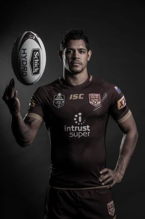 Rugby League player studio headshot spinning ball