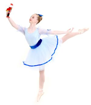 Ballerina on pointe in arabesque