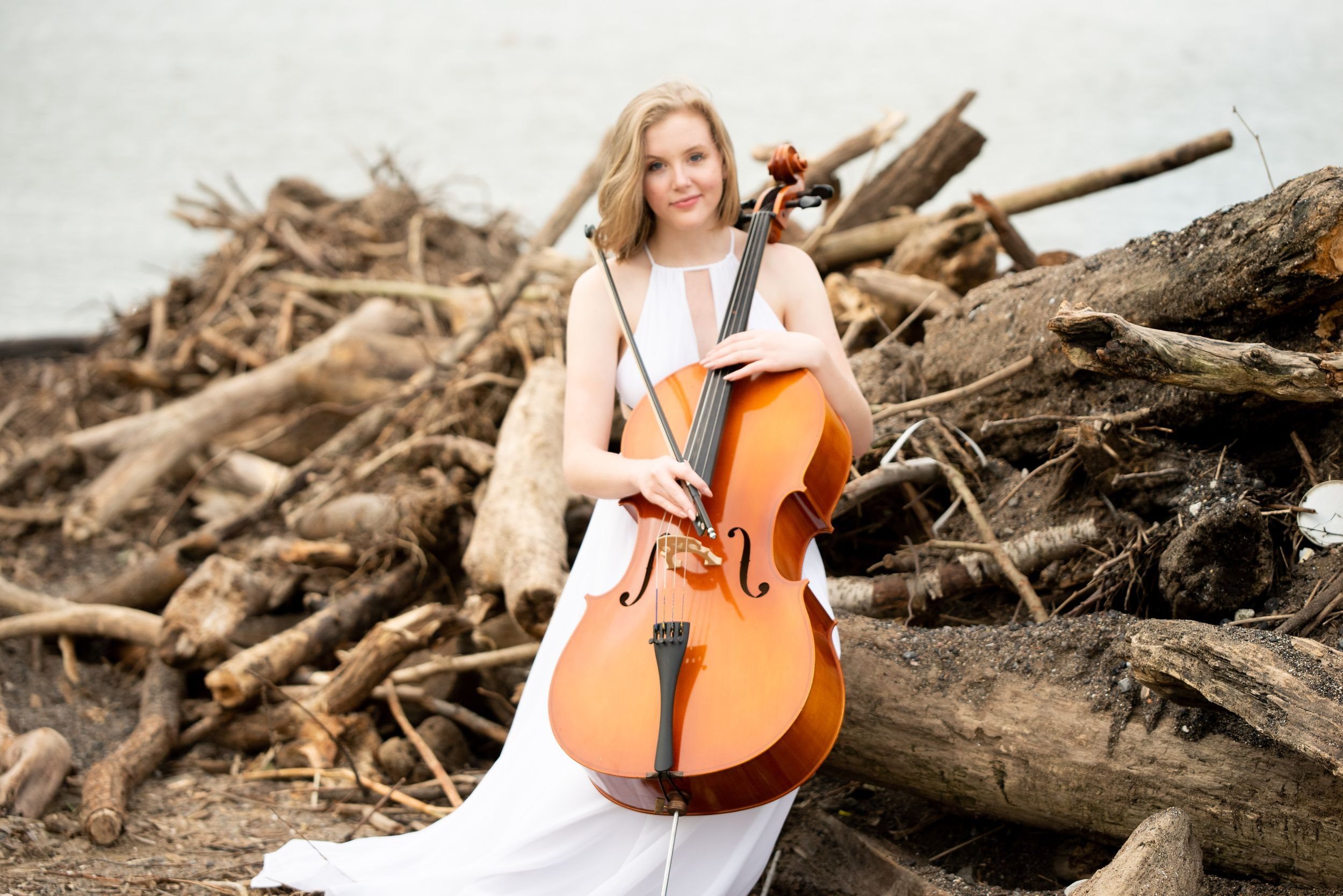 senior girl with cello on the shore of Lake Erie