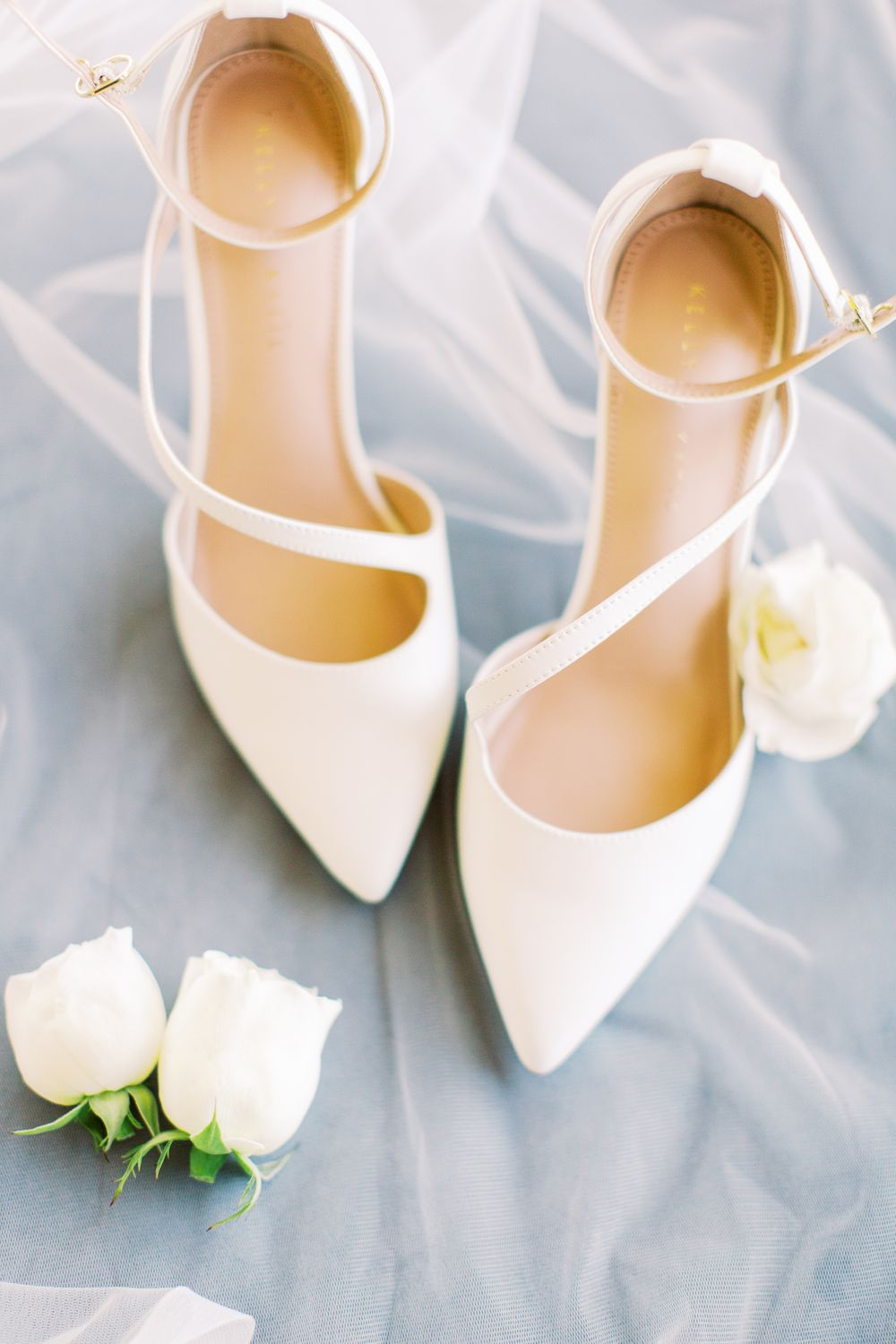 bride's shoes styled with veil and flowers on wedding day in savannah, ga