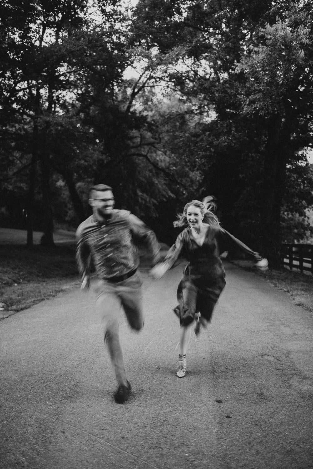 couple running down a road in Nashville Tennessee