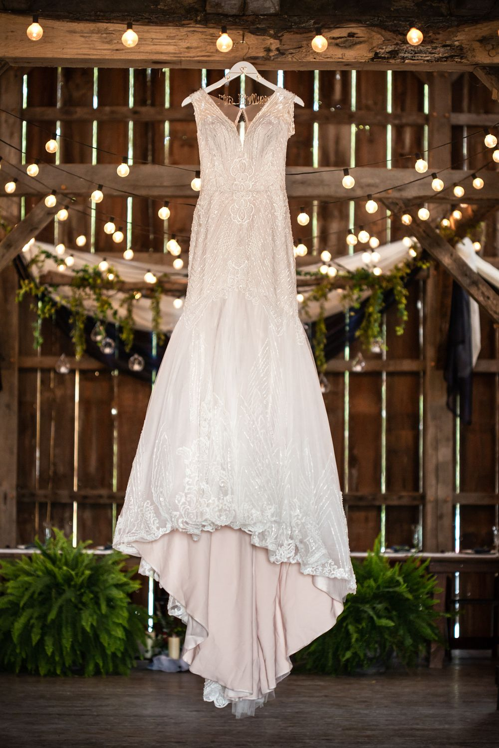 Elegant wedding gown hanging in Heritage Ranch