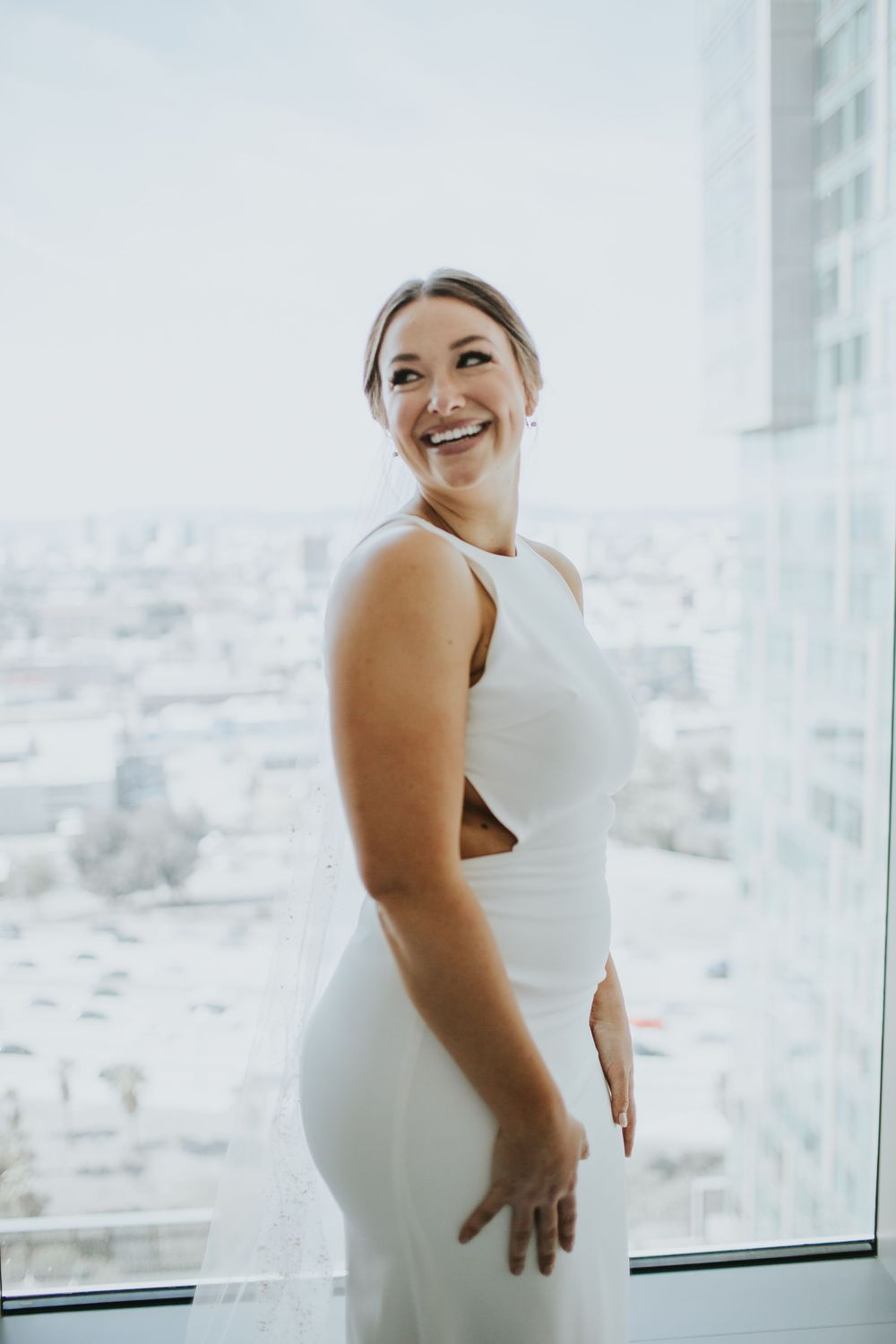 associate photographer photo of bride laughing over her shoulder